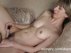Destine fills her hairy pussy with a toy.