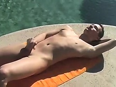 While Tyler is laying poolside naked jerking on his dick he