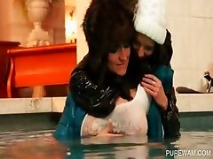 Lesbo clothed sluts get wet in the pool